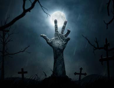 Zombie Hand aus einem Grab gestreckt